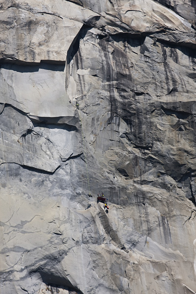 Steve is lowered out from the portaledge ready to start climbing.